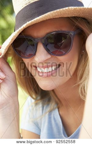 Head And Shoulders Portrait Of Smiling Woman With Sun Hat