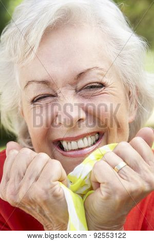 Head And Shoulders Portrait Of Smiling Senior Woman
