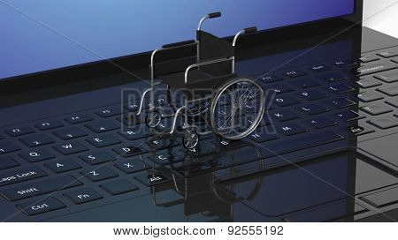 Wheelchair on black laptops keyboard, conceptual