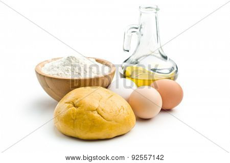 dough and ingredients for preparing pasta on white background