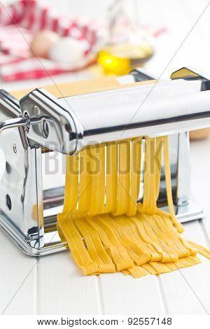 pasta machine on kitchen table