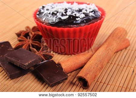 Muffins With Desiccated Coconut, Chocolate, Anise And Cinnamon