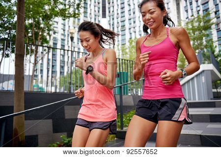 asian chinese sporty women running down stairs outdoors for morning workout