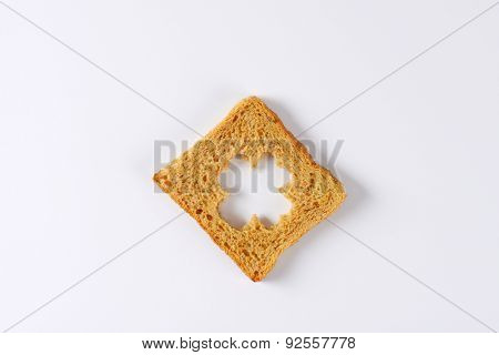 slice of toast bread with cutting of clover in the middle