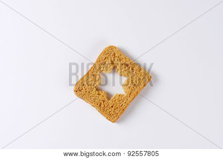 slice of toast bread with curved star in the middle