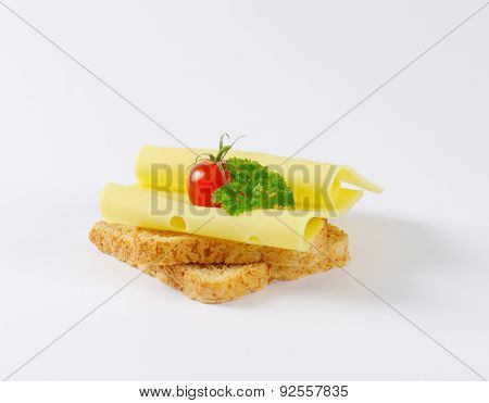 toast bread with slices of hard cheese and cherry tomato