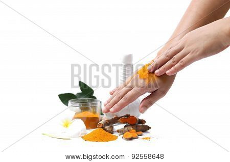 Women Applying Curcuma  To Hands