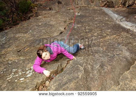 Young Girl Is Climbing Up
