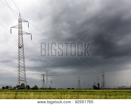 Voltage Pylons During A Thunderstorm