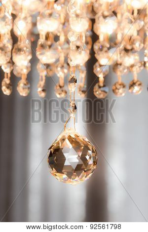 Detail Of A Crystal Chandelier That Shines Light
