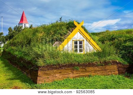 Village of ancestors. The recreated village -  museum of first settlers in Iceland. Houses are roofed by the turf and grass