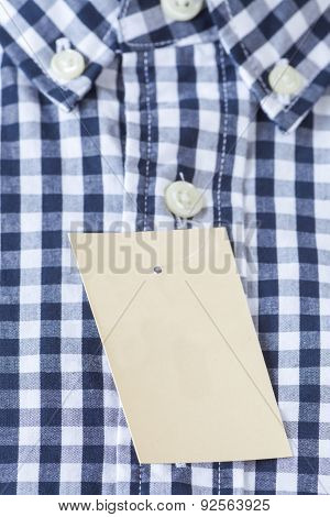 Close - up Blank tag label on check shirt