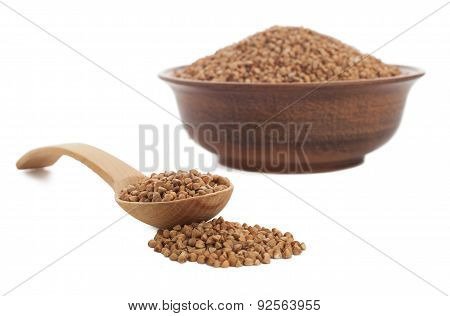 Buckwheat In Bowl With Wooden Spoon On White.