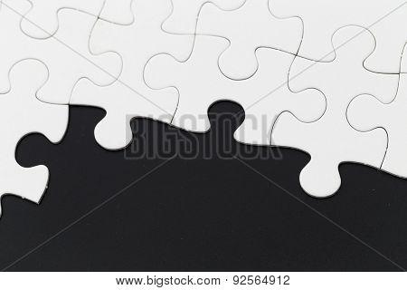 Plain puzzle on black background