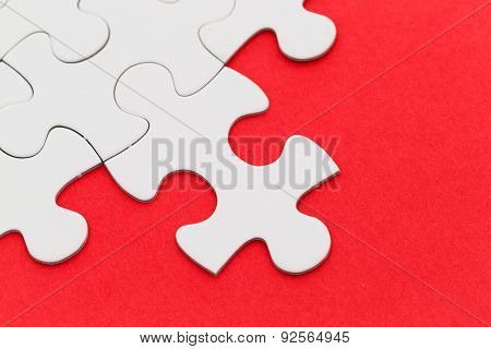 Jigsaw puzzle with missing red background