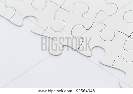White incomplete jigsaw puzzle