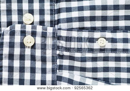 Close - up Black and white check shirt sleeve and button
