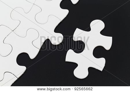 Jigsaw pieces isolated on black Jigsaw and puzzles concepts