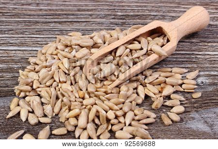 Sunflower Seeds With Spoon On Wooden Background