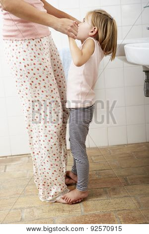 Mother And Daughter Having Fun In Bathroom