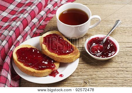 Toasted Bread With Strawberry Jam And Tea