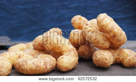 Picture of a many crunchy peanuts snacks