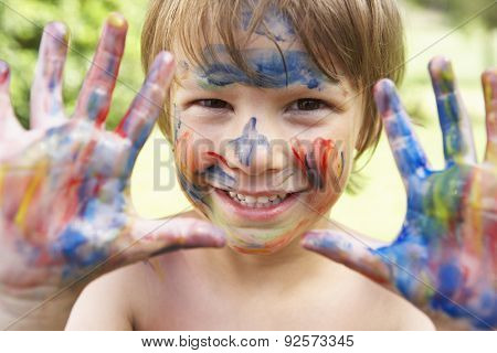 Head And Shoulders Portrait Of Boy With Painted Face and Hands