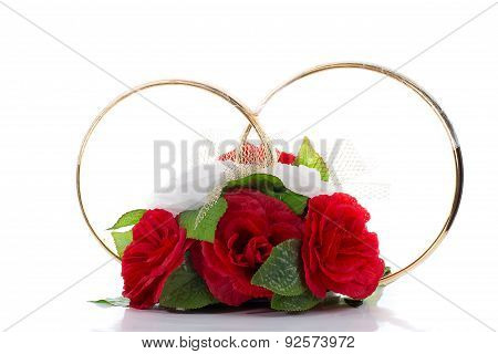 A Flower Arrangement With Big Golden Rings For A Wedding