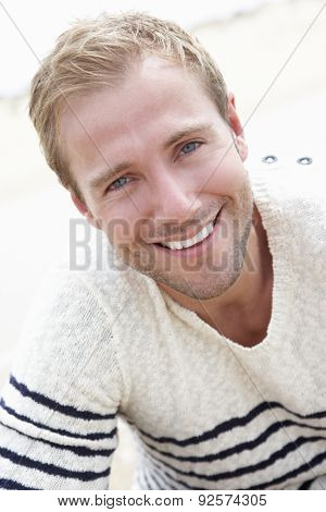 Outdoor Portrait Of Smiling Young Man