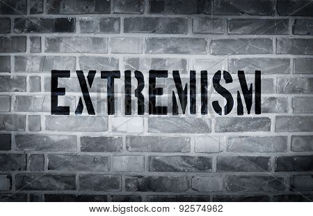 Extremism Stencil Print On The Grunge White Brick Wall