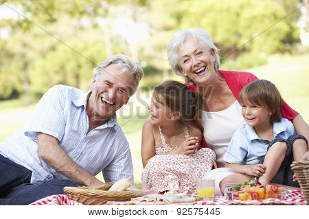 Grandparents And Grandchildren Enjoying Picnic Together