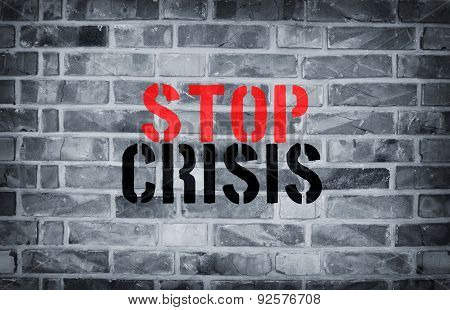 Stop Crisis Stencil Print On The Grunge White Brick Wall