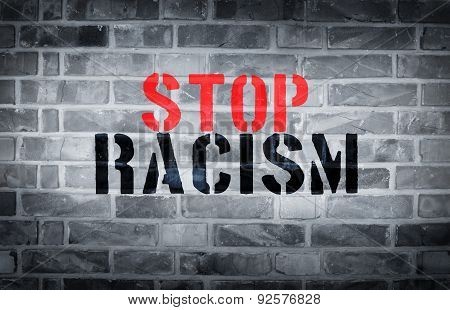 Stop Racism Stencil Print On White Wall Background