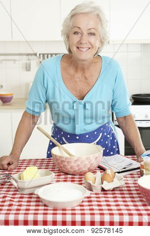 Senior Woman Baking In Kitchen