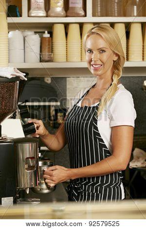 Woman Making Coffee In Shop