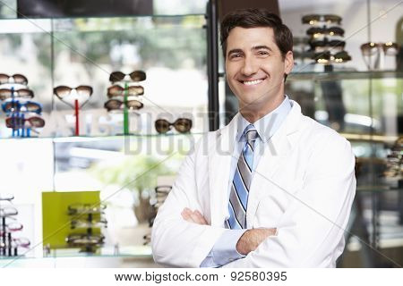 Portrait Of Male Optician By Glasses Display