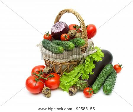 Vegetables In A Basket And Quail Eggs On A White Background