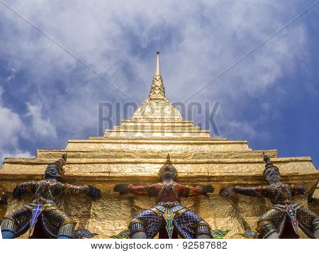 Titans and monleys carry golden pagoda decoration in temple of emerald Buddha