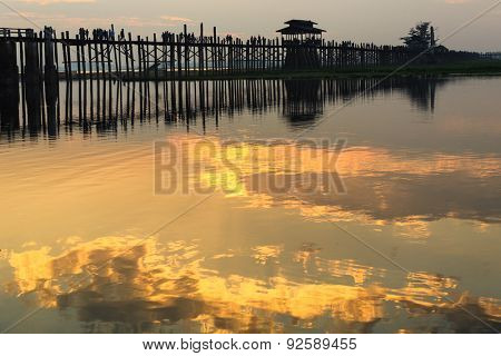 U bein wooden teck bridge at dusk in Myanmar
