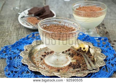 Vanilla Panna Cotta With Chocolate On A Wooden Background. Selective Focus