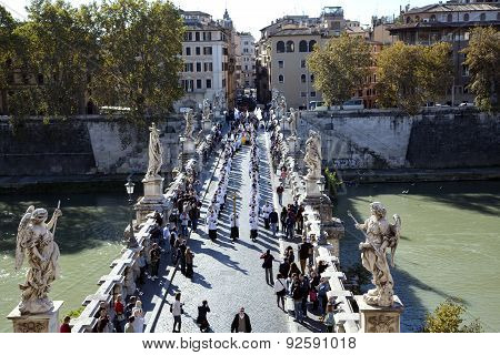 Festive procession of priests on a Saint Angelo Bridge
