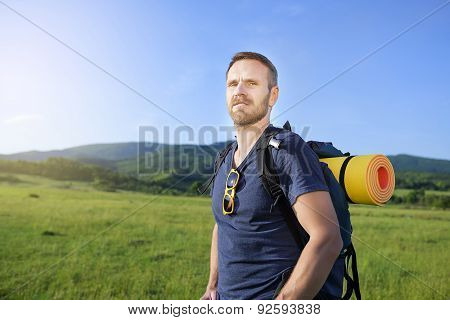 Hiker On The Hillside.