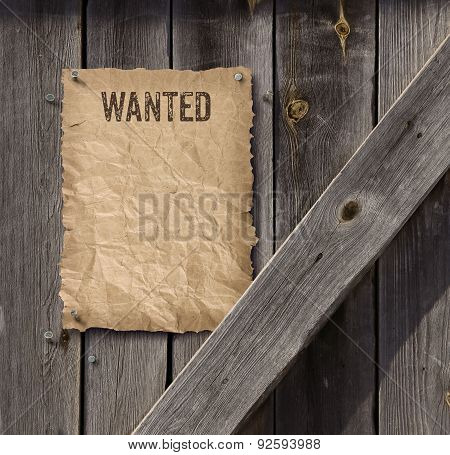 Wanted Poster On Weathered Plank Wood Door