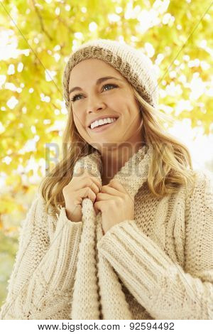 Woman Wearing Warm Clothes Under Autumn Tree