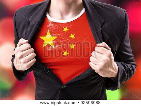 Businessman stretching suit with Chinese Flag on bokeh background
