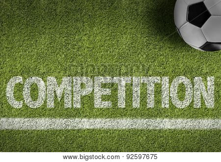 Soccer field with the text: Competition