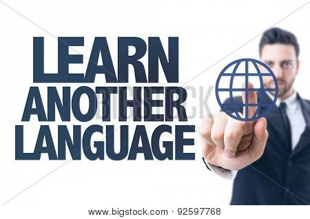 Business man pointing the text: Learn Another Language