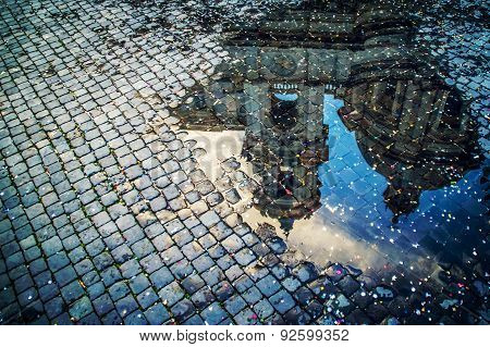 A puddle reflection on Piazza Navona, Italy