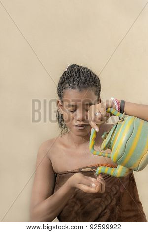 Young Afro beauty toileting