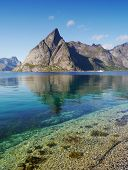stock photo of lofoten  - The contrast of sea and mountains in Lofoten - JPG